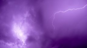 Lightning bolt. Beautiful lightning bolt with purple tone stock photography