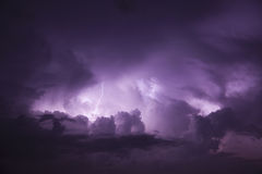 Lightning bolt. Beautiful lightning bolt with threatening dark clouds royalty free stock photo