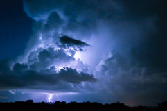 Lightning bolt. A cloud to ground lightning strike during a storm stock image