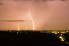 Lightning bolt over city Royalty Free Stock Photos