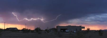 A Lightning Bolt Streaks Above a Neighborhood Royalty Free Stock Image
