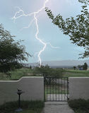 A Lightning Bolt Strikes Outside the Gate Stock Image