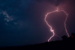 Lightning bolt striking. In the sky from clouds Stock Photography