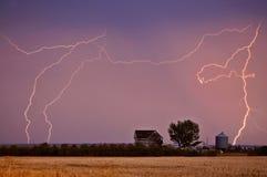 Lightning bolts. Seen behind Saskatchewan farmyard Saskatchewan Canada Stock Photos