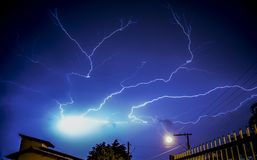 Lightning bolts above buildings