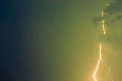Lightning bolts against the backdrop of a thundercloud. Stock Images