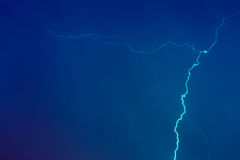 Lightning bolts against the backdrop of a thundercloud. Royalty Free Stock Images