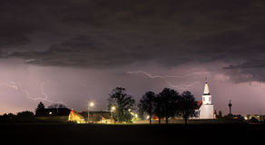 Lightning bolts over church Royalty Free Stock Image