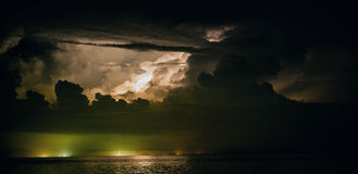 Lightning bolts over the sea Stock Photo