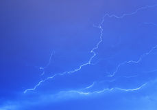 Lightning bolts in the sky Stock Images