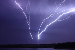 Lightning bolts striking antennas Royalty Free Stock Photography