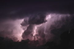 Lightning through the clouds. Lightning bolt strikes through a towering cumulus cloud Stock Images