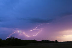 Lightning in the cloudy sky. Royalty Free Stock Photo