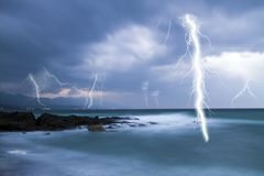 Lightning in cloudy sky Stock Photos