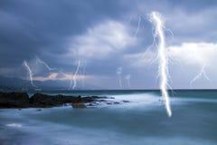 Lightning in cloudy sky Stock Photos