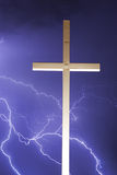 Lightning and the Cross Vertical. Lightning thunder storm with a religious cross. Blue in color. Vertical Image Royalty Free Stock Photography