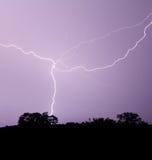 Lightning Crosses Purple Sky Stock Image