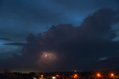 Lightning. The dark clouds and lightning in evening sky Royalty Free Stock Photos
