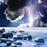 Lightning. Dark ominous clouds. Summer storm beginning with lightning Stock Photo