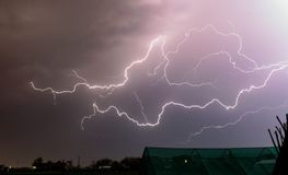 Lightning bolts creep through the sky during a severe springtime thunderstorm in Romania stock image