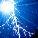 Lightning flash. On a blue background Royalty Free Stock Image