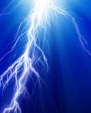 Lightning flash. Fierce lightning on a dark blue background Royalty Free Stock Images