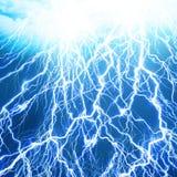Lightning flash. On a soft blue background Stock Photo
