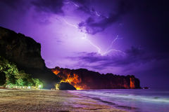 Lightning flashes on beach Stock Photo