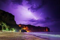 Lightning flashes on beach Stock Photo