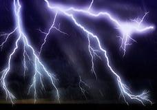 Lightning galore. Striking over ocean Stock Photography