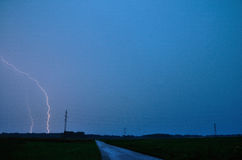 Lightning on the ground. Strong light lightning strikes one in the ground Royalty Free Stock Photo