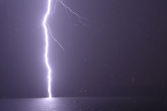 Lightning bolt in heavy rain storm Royalty Free Stock Image
