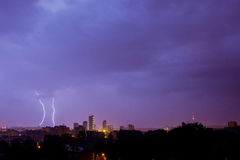 Lightning hits the city. On a rainy night Stock Photos