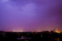 Lightning hits the city. On a rainy night Stock Image