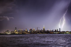Lightning hitting a New York City skyscraper at twilight Royalty Free Stock Photos