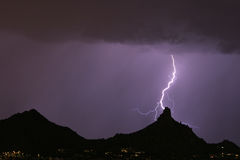 Lightning hitting pinnacle peak. Purple in color Stock Photography