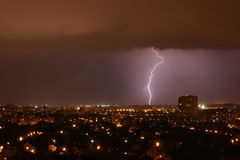Lightning on the horizon. Lightning strikes in the night city Royalty Free Stock Images