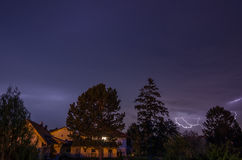 Lightning houses and trees. Bright lightning between houses and trees Royalty Free Stock Photos