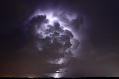 Lightning inside a thunderstorm. Lightning illuminating the inside of a thunderstorm cloud Royalty Free Stock Image