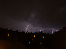 Lightning in Latvia Riga. Thunder rainy night storm Stock Image