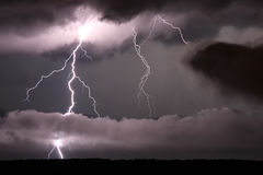 Lightning and low clouds Stock Images