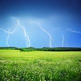 Lightning in meadow Stock Photo