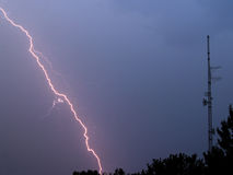 Lightning misses radio tower. This lightning storm passed over quickly, with numerous lightning strikes.  The lightning never hit this tower, though Stock Photography