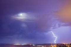 Lightning and moon couple Royalty Free Stock Images