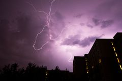 Lightning near buildings. In urban area Royalty Free Stock Images