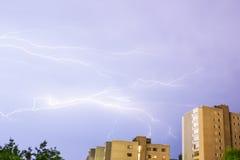 Lightning near buildings. In urban area Stock Photography