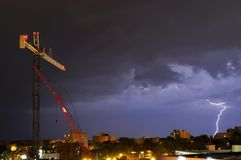 Lightning near a construction site in the city Stock Photos