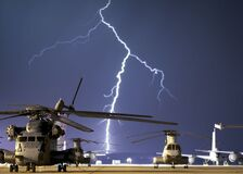 Lightning Near Grey Helicopter during Daytime Stock Images
