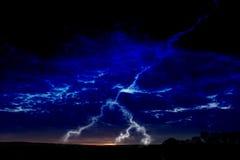 Lightning at night. Lightning in dark blue sky Stock Image