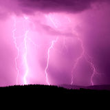 Lightning night. Night full of purple lightning Royalty Free Stock Images